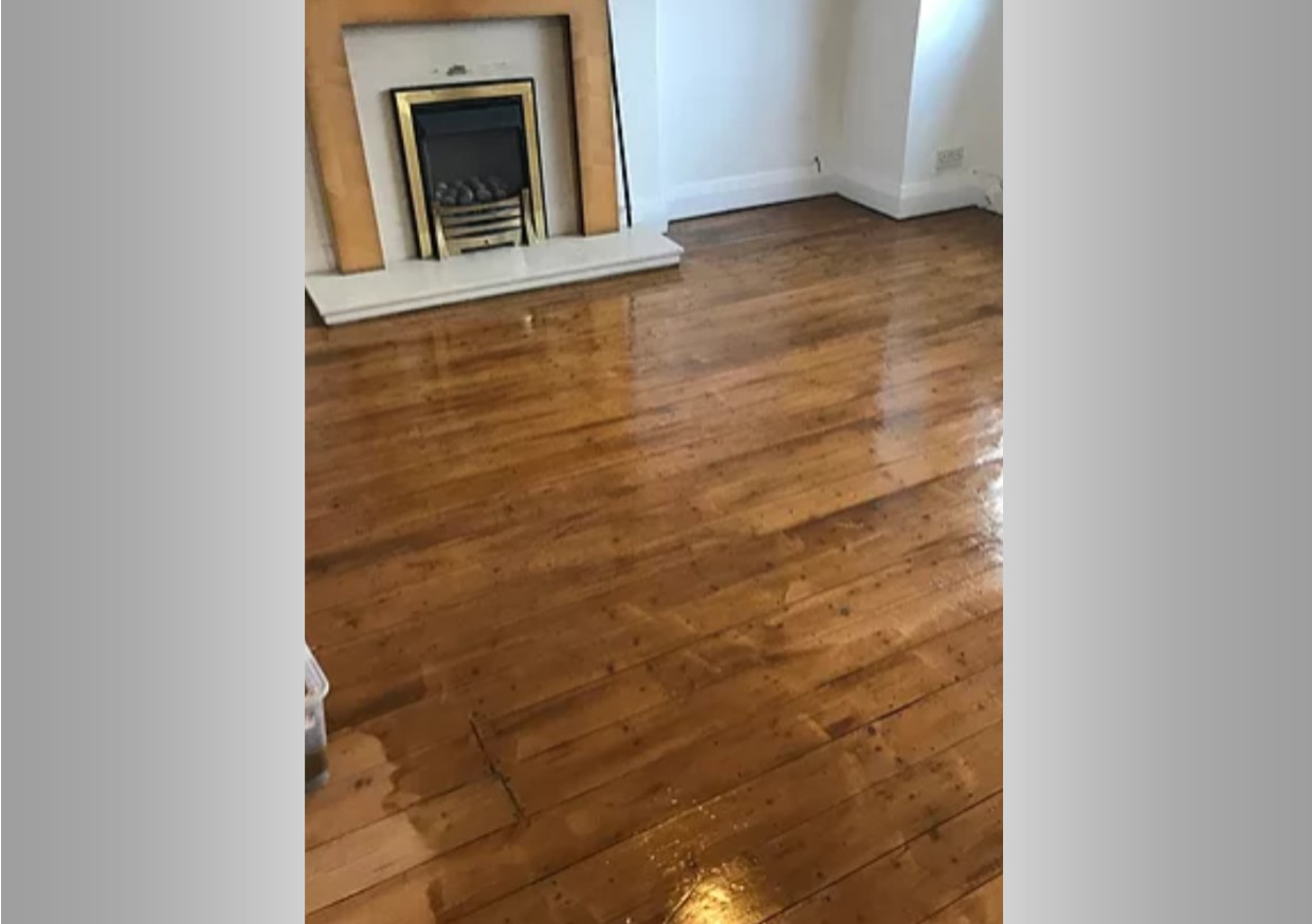 A picture of a floor that once looked tired has now been completely transformed with painting and decorating services