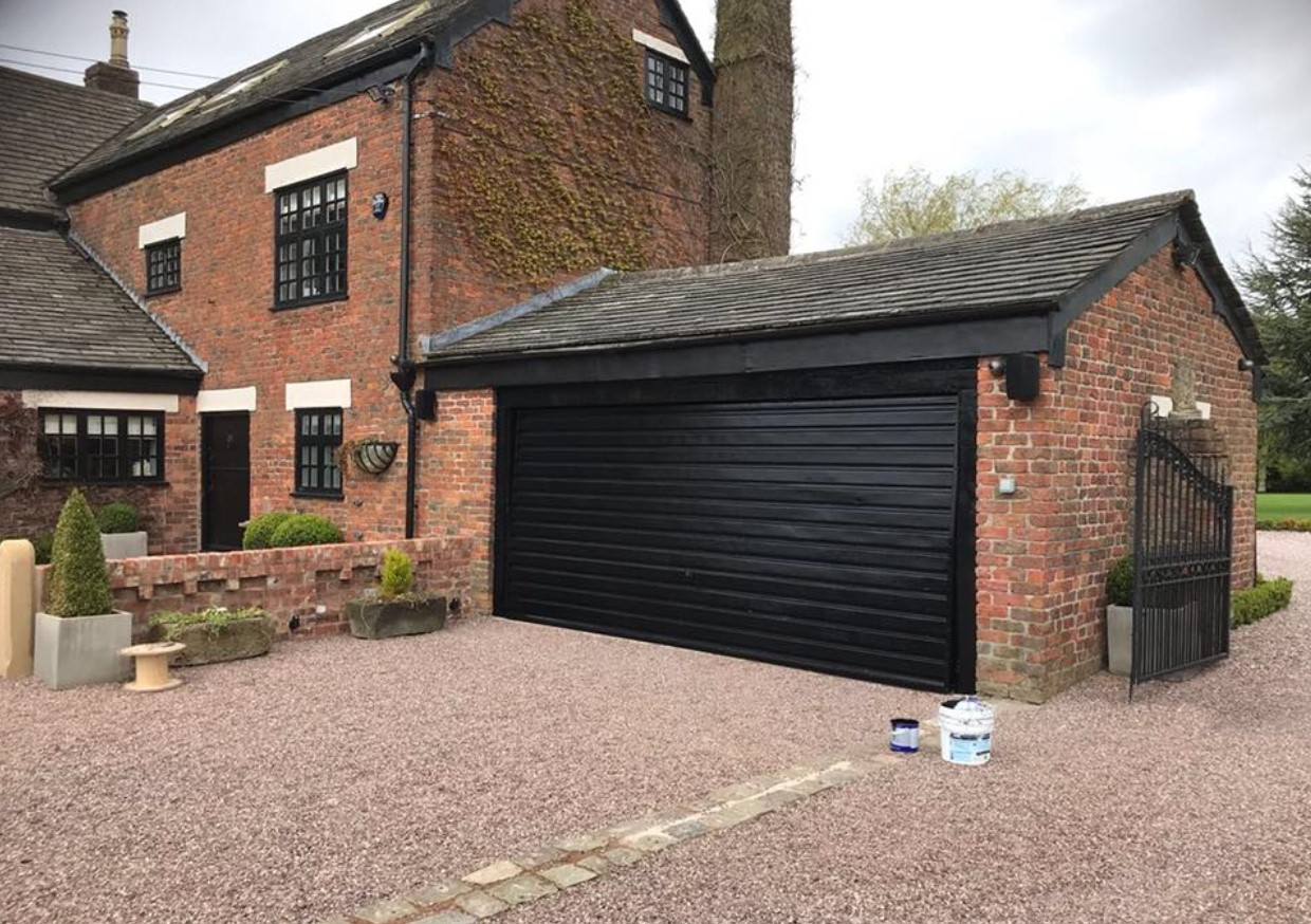 A picture of a garage door that has been restored and completely transformed