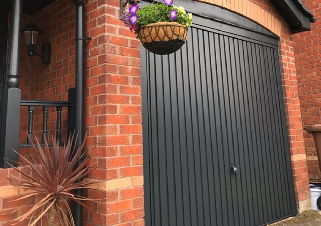An illustration of a garage door that Spray UPVC have resprayed to provide quality and value