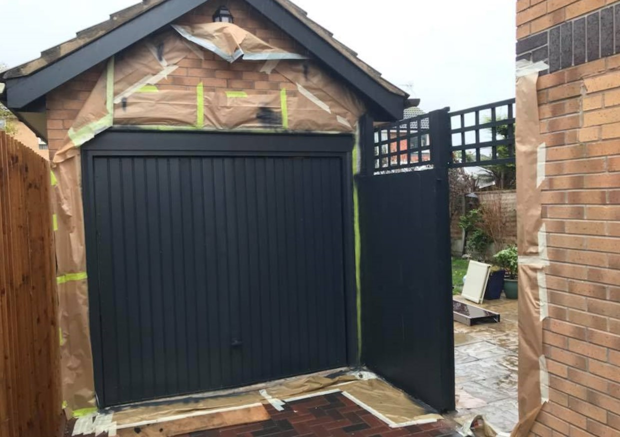 An image of a garage door that Spray UPVC have completely transformed with their UPVC respraying process