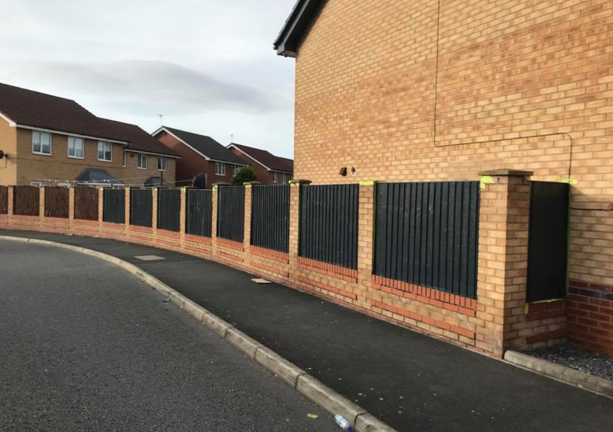 An image of a fence that has been sprayed by Spray UPVC