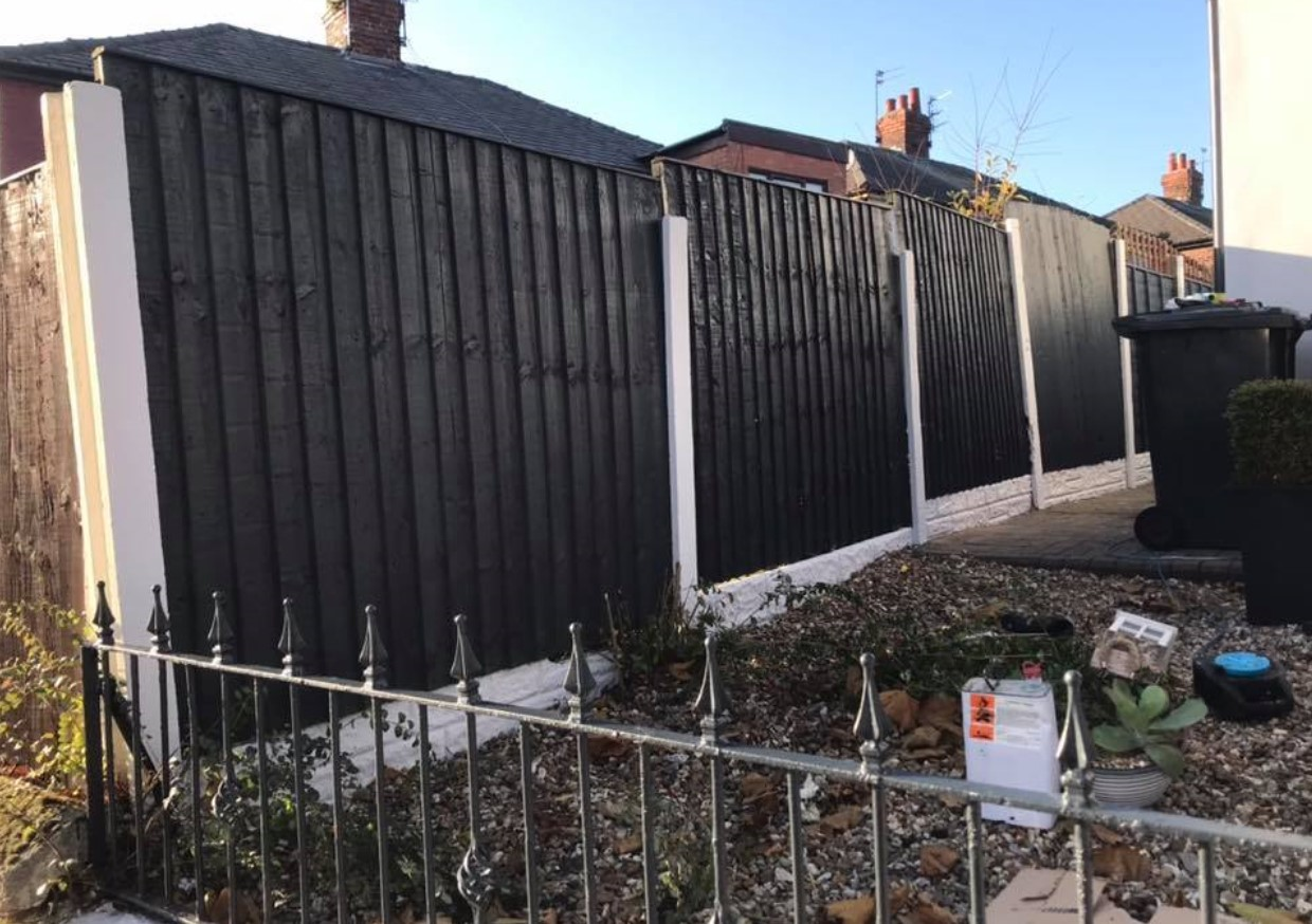 A picture of a fence that has been completely transformed by Spray UPVC