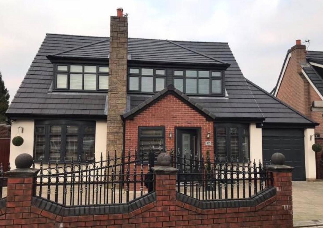 Using their UPVC respraying service, Spray UPVC have transformed the exterior of this house including the windows and doors